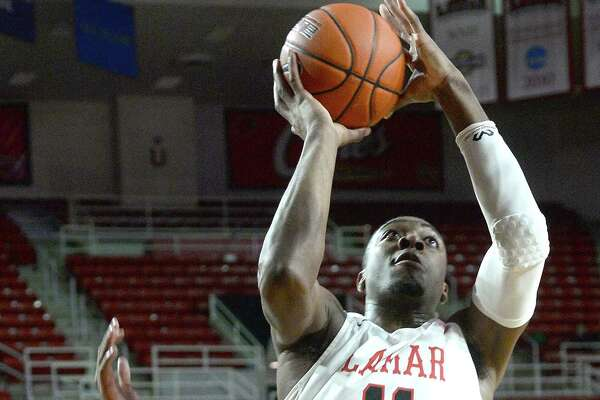 Lamar's Josh Nzeakor gets past Incarnate Word's Charles Brown III to shoot for two points during their Southland Conference match-up Wednesday at the Montagne Center. Photo taken Wednesday, January 23, 2019 Photo by Kim Brent/The Enterprise