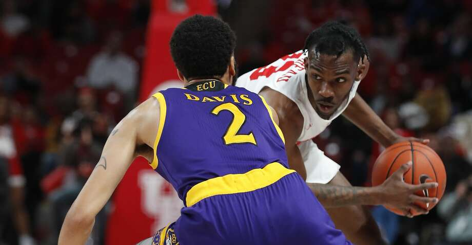 Houston guard Dejon Jarreau (13) works against East Carolina guard K.J. Davis (2) during the first half on a NCAA basketball game at Fertitta Center on Wednesday, Jan. 23, 2019, in Houston. Photo: Brett Coomer/Staff Photographer