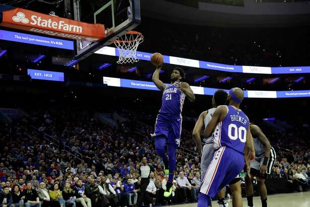 Philadelphia 76ers' Joel Embiid (21) goes up for a dunk during the first half of an NBA basketball game against the San Antonio Spurs, Wednesday, Jan. 23, 2019, in Philadelphia. (AP Photo/Matt Slocum)