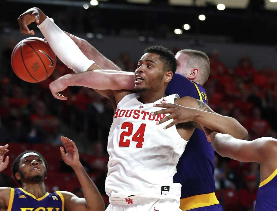 Houston forward Breaon Brady (24) gets tangled up with East Carolina forward Dimitrije Spasojevic going for a rebound during the first half on a NCAA basketball game at Fertitta Center on Wednesday in Houston. Photo: Brett Coomer, Houston Chronicle / Staff Photographer / © 2019 Houston Chronicle