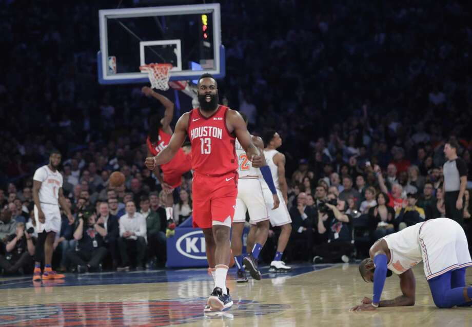 Houston Rockets' James Harden (13) reacts after teammate Kenneth Faried (35) dunked the ball during the second half of the team's NBA basketball game against the New York Knicks on Wednesday, Jan. 23, 2019, in New York. Harden scored 61 points as the Rockets won 114-110. (AP Photo/Frank Franklin II) Photo: Frank Franklin II, STF / Associated Press / Copyright 2019 The Associated Press. All rights reserved.