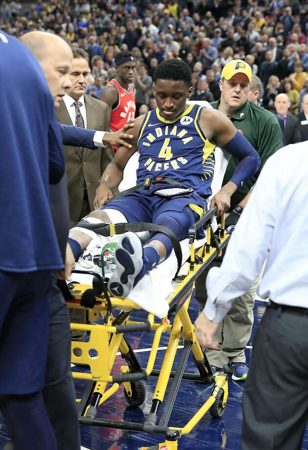Pacers shooting guard Victor Oladipo is wheeled off the court in Indianapolis after suffering a serious right knee injury. Photo: Andy Lyons / Getty Images