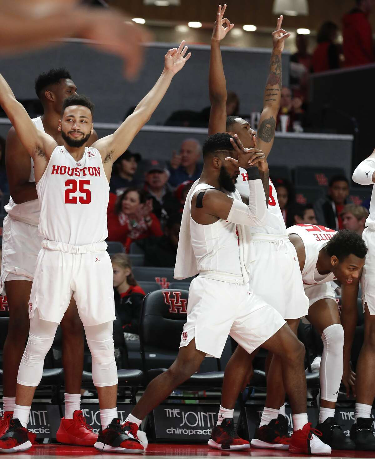 The Houston bench celebrates a 3-pointer made by the Cougars during the second half on a NCAA basketball game against East Carolina at Fertitta Center on Wednesday, Jan. 23, 2019, in Houston. The Cougars won 94-50.