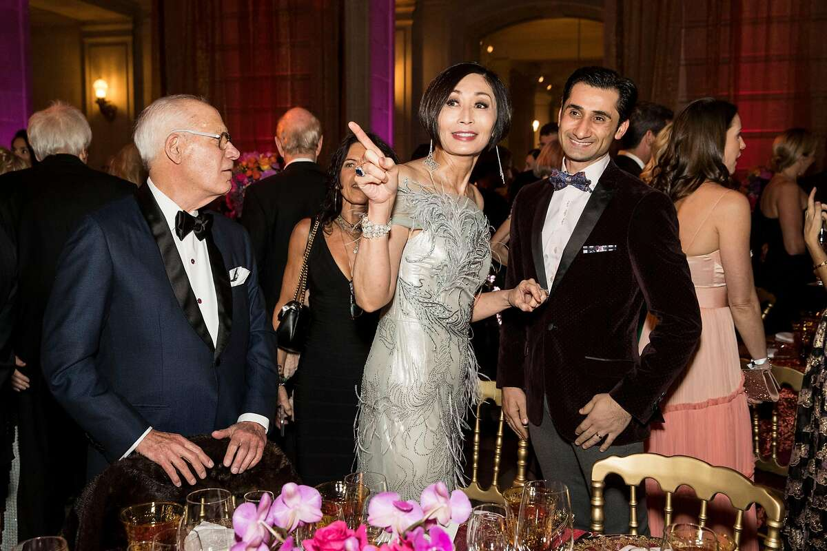 """Yurie Pascarella (center) talks with former San Francisco Ballet principal dancer Davit Karapetyan (right) during the San Francisco Ballet Opening Night Gala at City Hall in San Francisco, Calif., on January 23, 2019. The theme of the evening was """"This is Passion."""""""