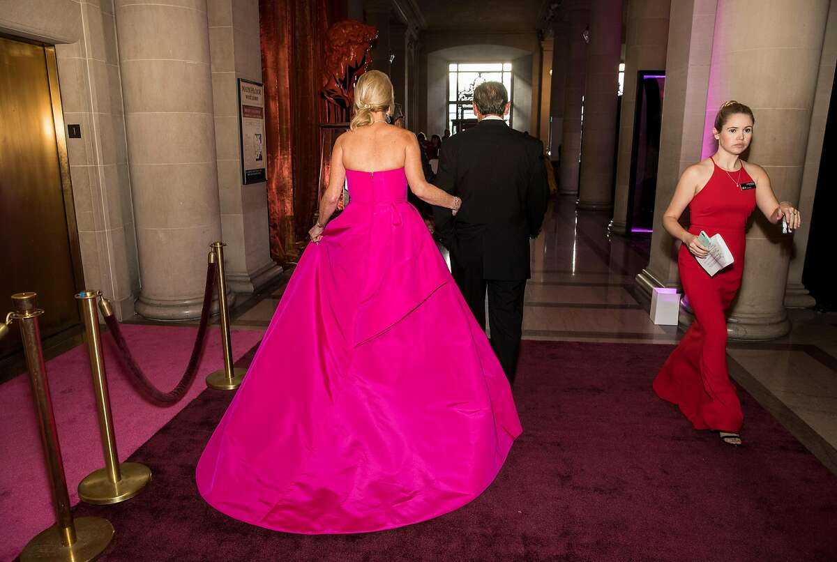 """San Francisco Ballet Opening Night Gala event chair Claire Kostic (left) walks through City Hall during the event in San Francisco, Calif., on January 23, 2019. The theme of the evening was """"This is Passion."""""""