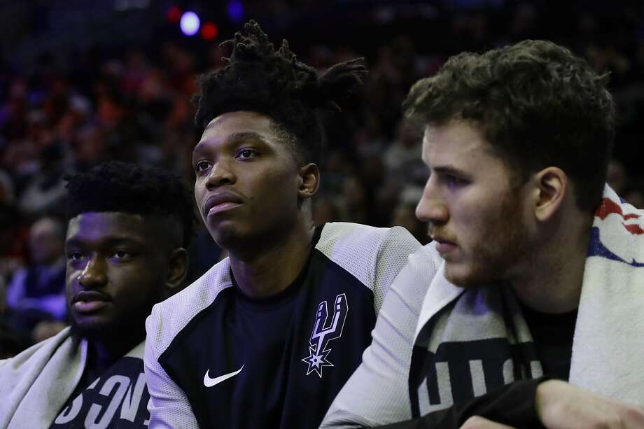 41b508860e2 San Antonio Spurs' Lonnie Walker IV, center, watches from the bench during  the