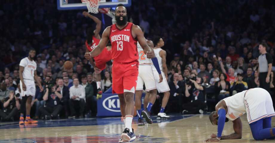 Houston Rockets' James Harden (13) reacts after teammate Kenneth Faried (35) dunked the ball during the second half of the team's NBA basketball game against the New York Knicks on Wednesday, Jan. 23, 2019, in New York. Harden scored 61 points as the Rockets won 114-110. (AP Photo/Frank Franklin II) Photo: Frank Franklin II/Associated Press