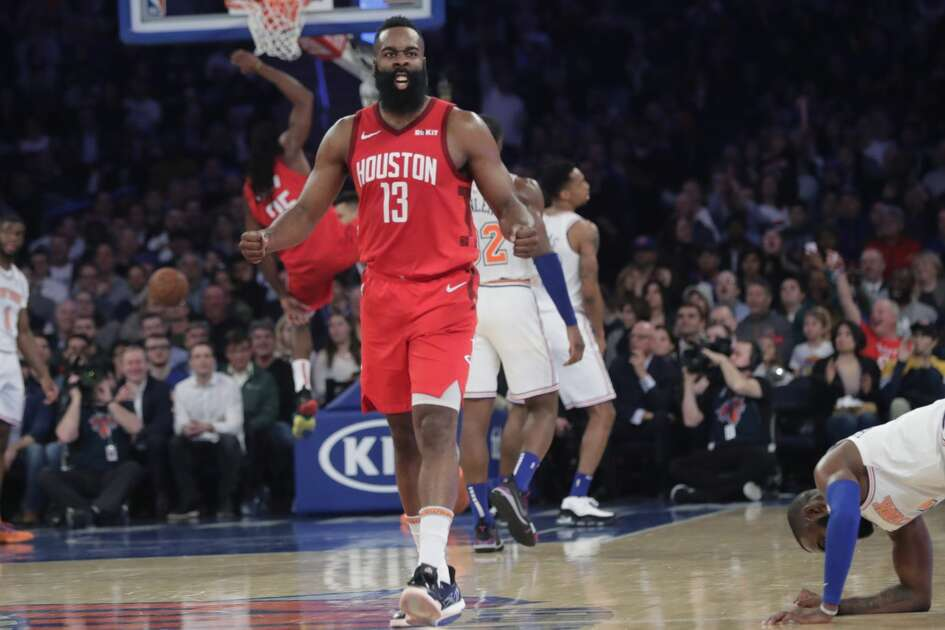Houston Rockets' James Harden (13) reacts after teammate Kenneth Faried (35) dunked the ball during the second half of the team's NBA basketball game against the New York Knicks on Wednesday, Jan. 23, 2019, in New York. Harden scored 61 points as the Rockets won 114-110. (AP Photo/Frank Franklin II)