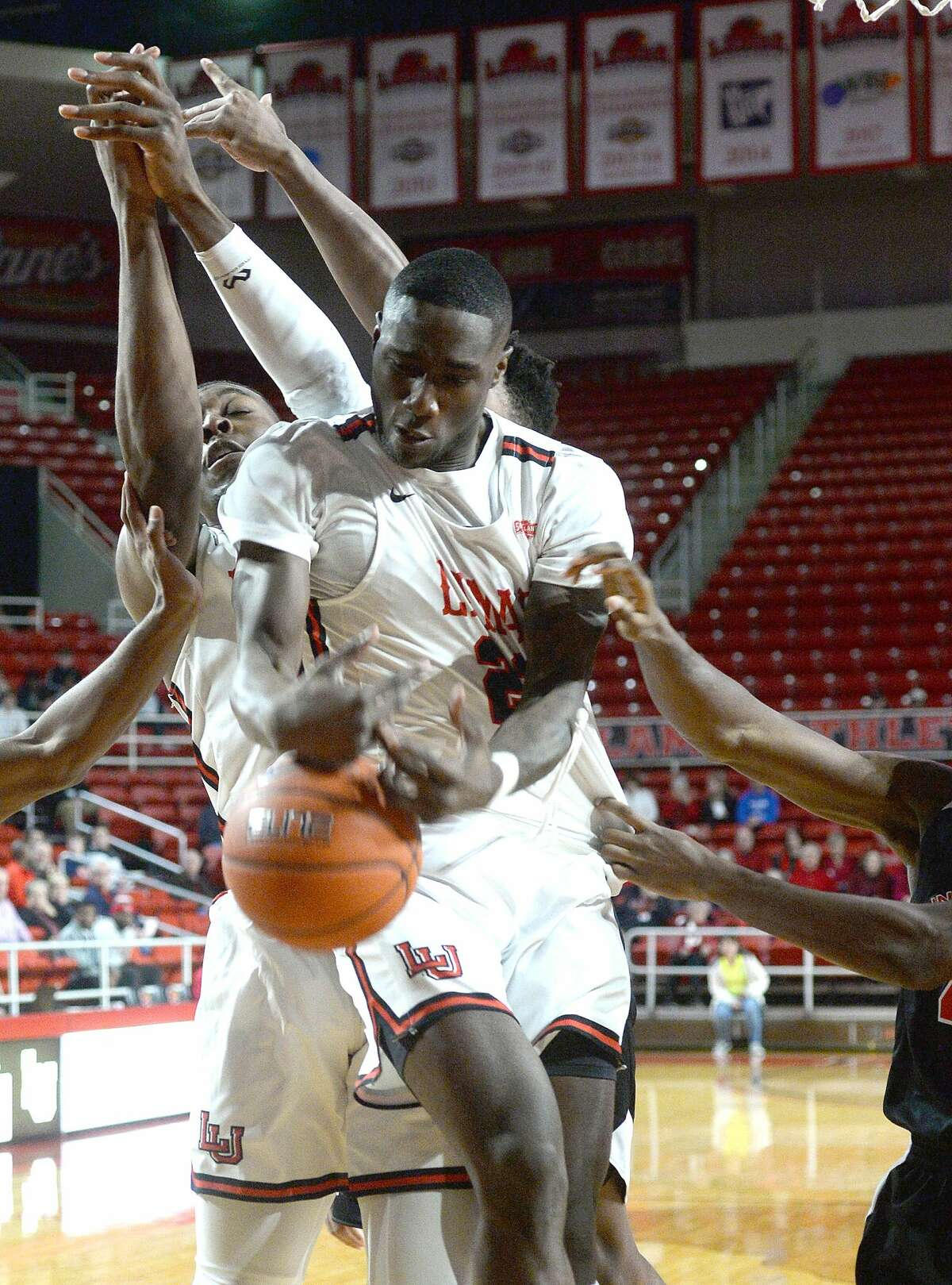 Lamar's Christian Barrett tries to secure the rebound from Incarnate Word during their Southland Conference match-up Wednesday at the Montagne Center. Photo taken Wednesday, January 23, 2019 Photo by Kim Brent/The Enterprise