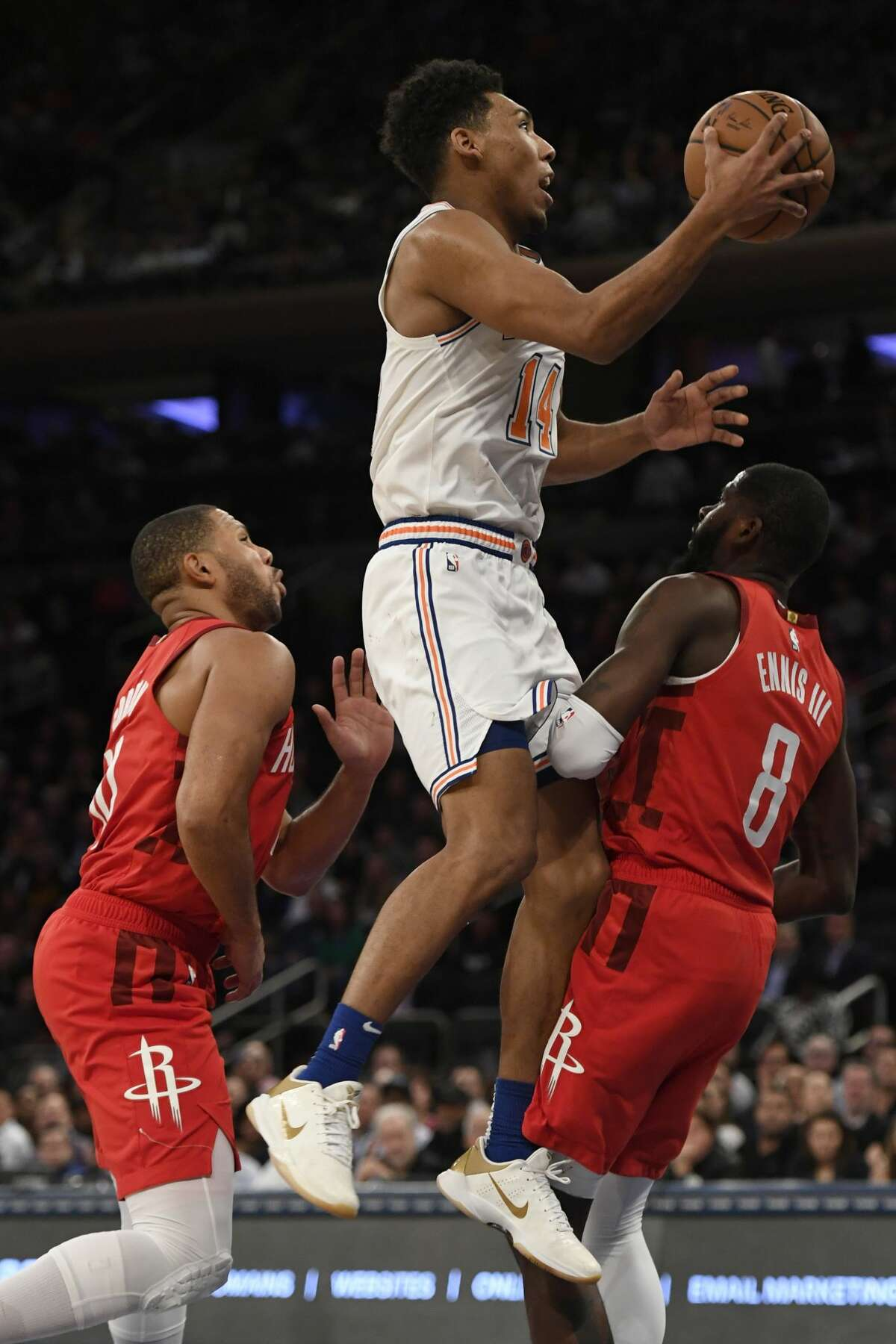 NEW YORK, NEW YORK - JANUARY 23: Allonzo Trier #14 of the New York Knicks attempts a basket during the fourth quarter of the game against the Houston Rockets at Madison Square Garden on January 23, 2019 in New York City. NOTE TO USER: User expressly acknowledges and agrees that, by downloading and or using this photograph, User is consenting to the terms and conditions of the Getty Images License Agreement. (Photo by Sarah Stier/Getty Images)