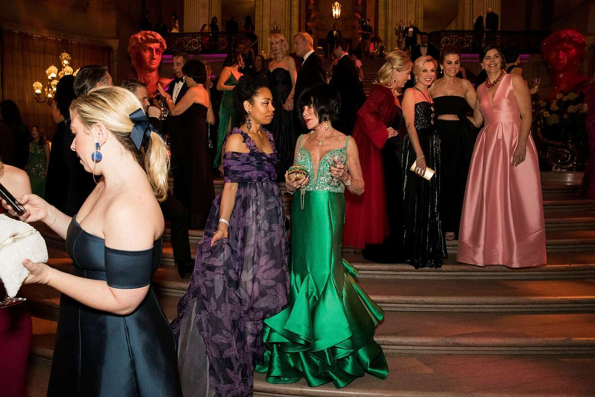 """Guests of the San Francisco Ballet Opening Night Gala gather on the steps of City Hall during the event in San Francisco, Calif., on January 23, 2019. The theme of the evening was """"This is Passion."""""""