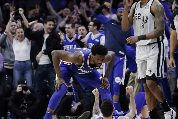 Philadelphia's JJ Redick celebrates with Joel Embiid after hitting a 3-pointer and drawing a foul on Rudy Gay. Redick's free throw capped a 4-point play and put the 76ers up for good with a minute left in a game the Spurs led by eight just 1:15 earlier.