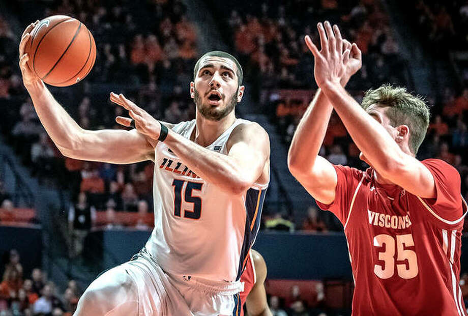 Giorgi Bezhanishvili of Illinois (15) goes up for a shot guarded by Nate Reuvers of Wisconsin Wednesday night in Champaign. Bezhanishvili scored 20 points and grabbed eight rebounds, but the Badgers, led by Reuvers' 22 points, beat the Illini 72-60. Photo: Craig Pressman, Illinois Athletics