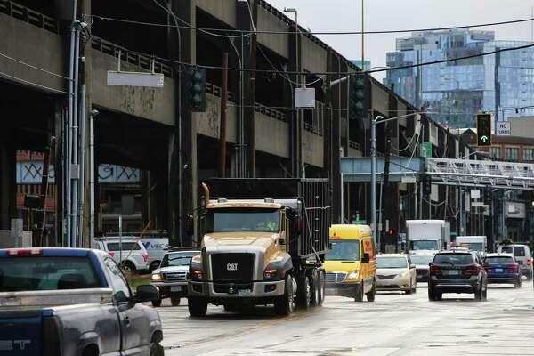 """Cars head north on Alaskan Way as traffic due to the closure of the Alaskan Way Viaduct builds midway through the second week of the """"Seattle Squeeze"""", Wednesday, Jan. 23, 2019."""