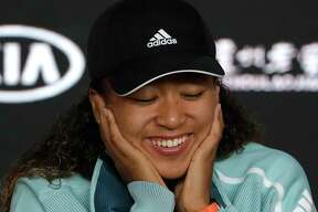 Japan's Naomi Osaka answers questions at a press conference following her win over Karolina Pliskova of the Czech Republic in their semifinal at the Australian Open tennis championships in Melbourne, Australia, Thursday, Jan. 24, 2019.