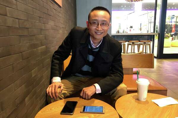 Zhang Jiaqian spends several hours a day trying to render President Trump's tweets into Chinese.