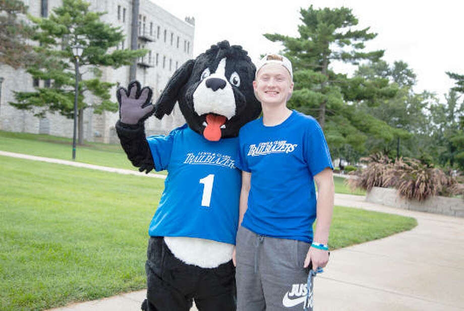 Blazer, L&C's Newfoundland mascot, poses with a Lewis and Clark Community College student on the college's Godfrey Campus in Fall 2018. Photo: Photo By Jan Dona, L&C Media Services