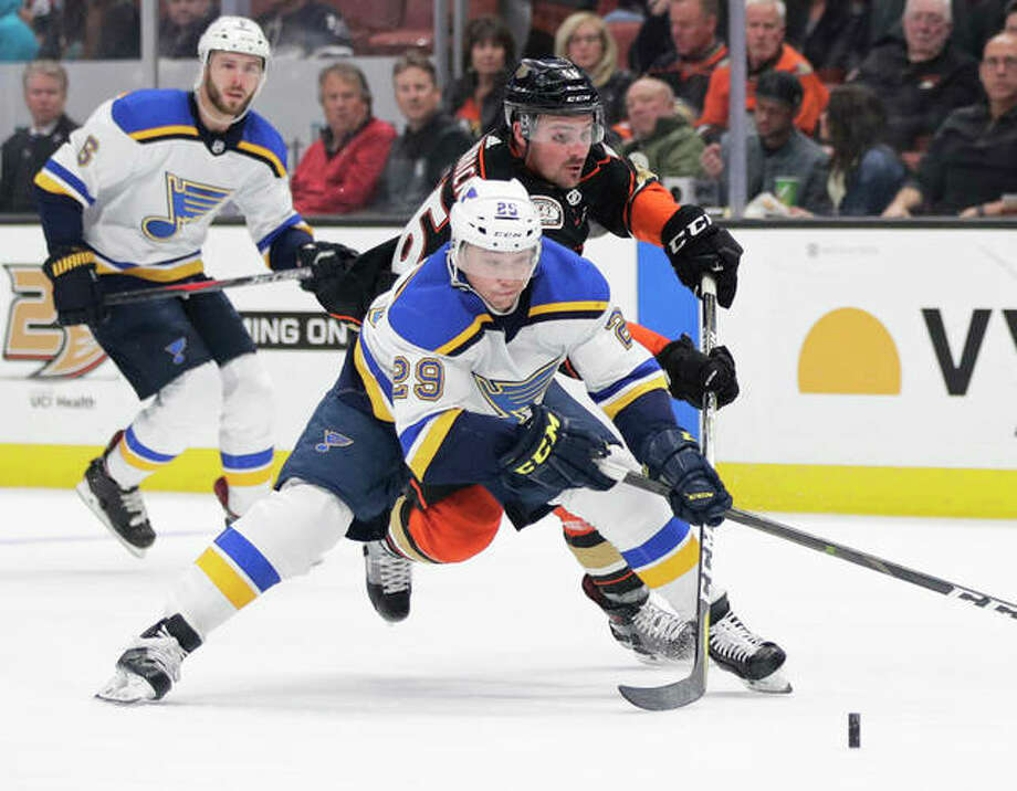 The Blues' Vince Dunn (front) and the Ducks' Sam Carrick chase the puck during the second period Wednesday night in Anaheim, Calif. Photo: Associated Press