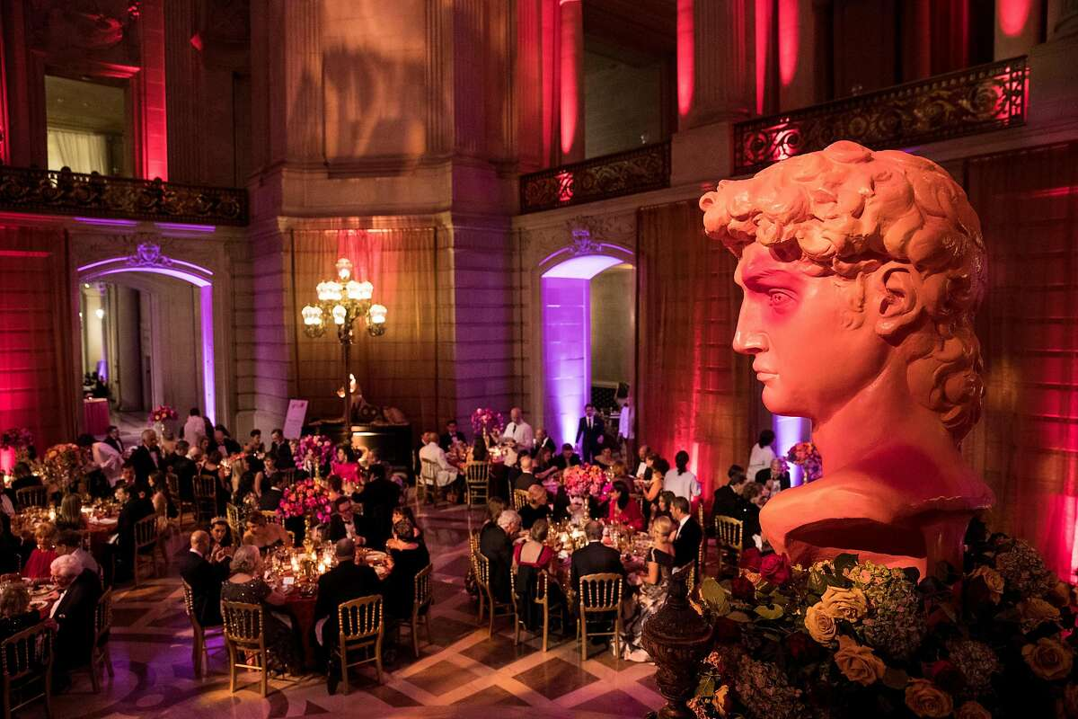 """Guests of the San Francisco Ballet Opening Night Gala sit down to dinner during the event at City Hall in San Francisco, Calif., on January 23, 2019. The theme of the evening was """"This is Passion."""""""