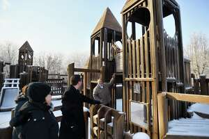 Mike Ganino, right, leads members of the Monroe Playground Foundation on a tour of the Kids Kreation playground at Wolfe Park in Monroe, Conn. on Monday, January 21, 2019. The group is raising money to replace the wooden playground, built in 1992, with a new version made of artificial materials.