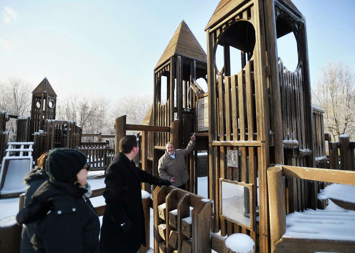 Mike Ganino, right, leads members of the Monroe Playground Foundation on a tour of the Kids Kreation playground at Wolfe Park on Jan. 21, 2019. The group is raising money to replace the wooden playground, built in 1992, with a new version made of artificial materials.