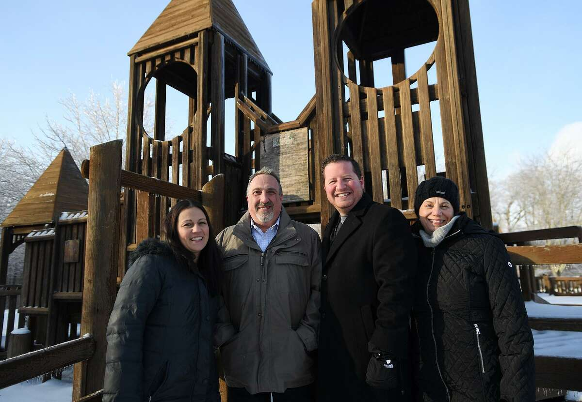 From left; Monroe Playground Foundation members Theresa Oleyar, Mike Ganino, Dan Keene, and Jennifer Cristo at the Kids Kreation playground at Wolfe Park in Monroe, Conn. on Monday, January 21, 2019. The group is raising money to replace the wooden playground, built in 1992, with a new version made of artificial materials.