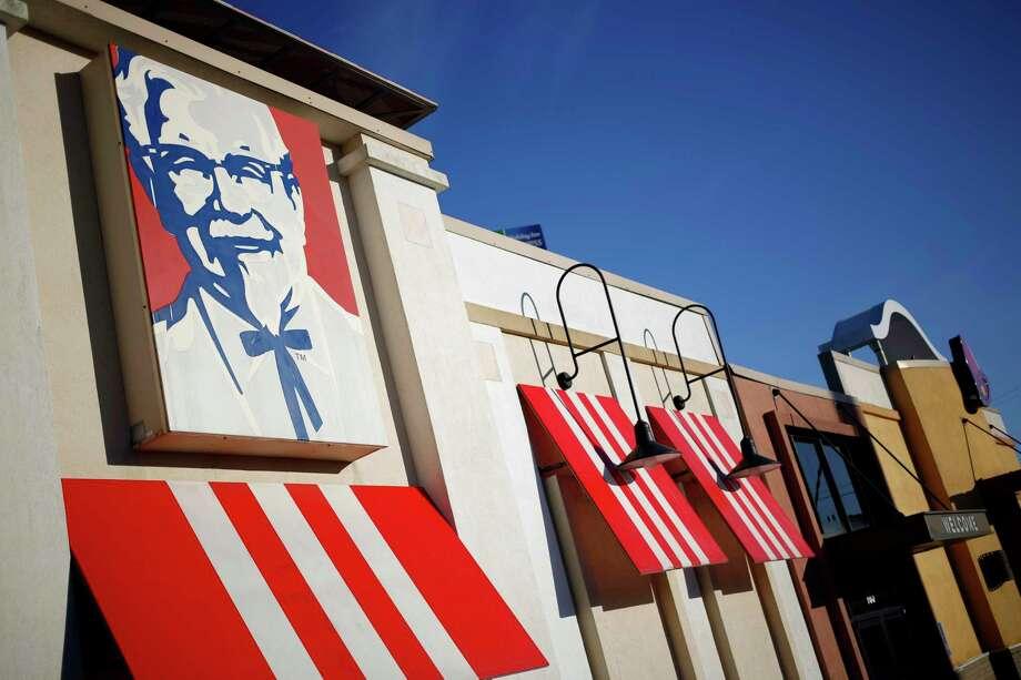 Yum! Brands Inc. Kentucky Fried Chicken (KFC) signage is displayed outside a restaurant in Elizabethtown, Kentucky. Photo: Bloomberg Photo By Luke Sharrett / Bloomberg