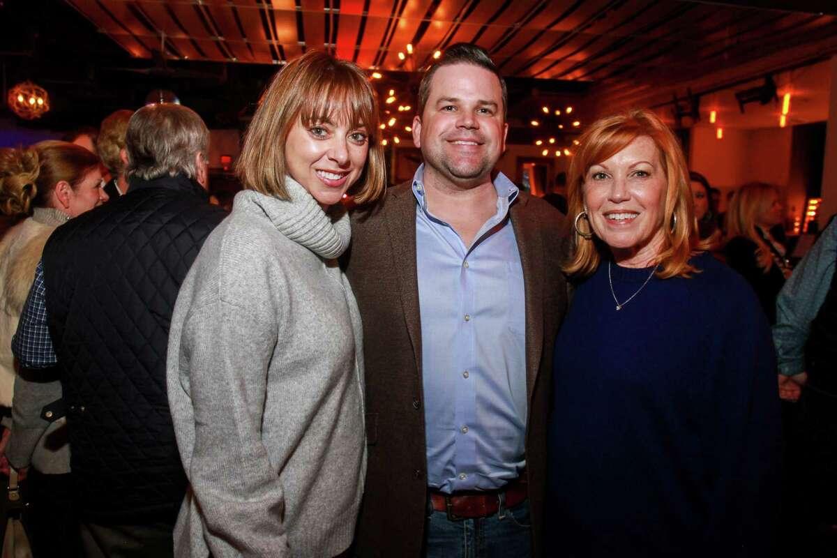 Lauren Maloy, from left, Douglas Plaeger and Gigi Harbison at the Cattle Baron's Ball 2019's Gentlemen's Committee Celebration at Daisy Duke's.