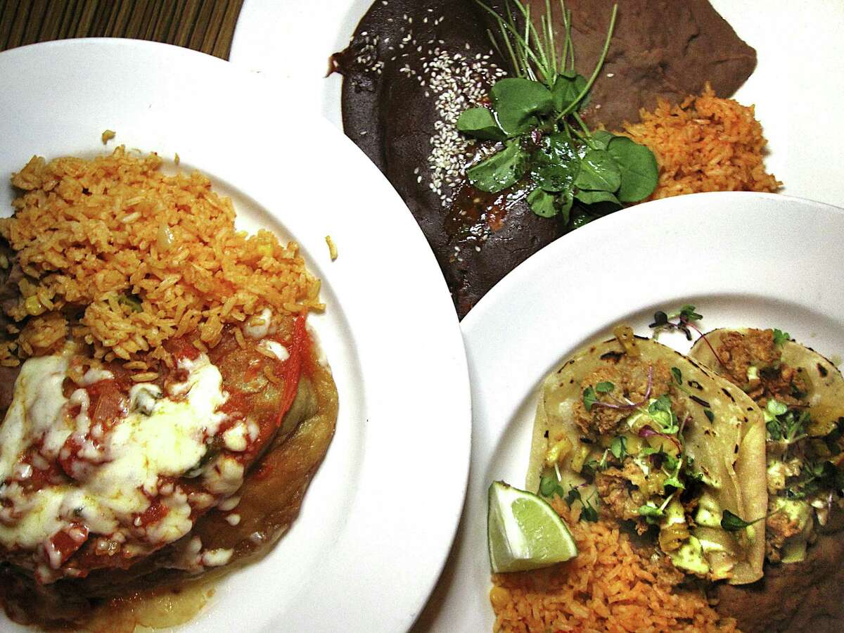 Chile relleno, chicken mole and fried oyster tacos from Ácenar Mexican restaurant on the River Walk.