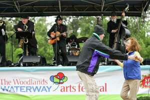 Porter residents Karl and Lupe Sharrah dance to music played by the Texas Gypsies during The Woodlands Waterway Arts Festival on Saturday, April 7, 2018, in The Woodlands. The 2019 festival will have numerous bands and singers performing on four different stages.