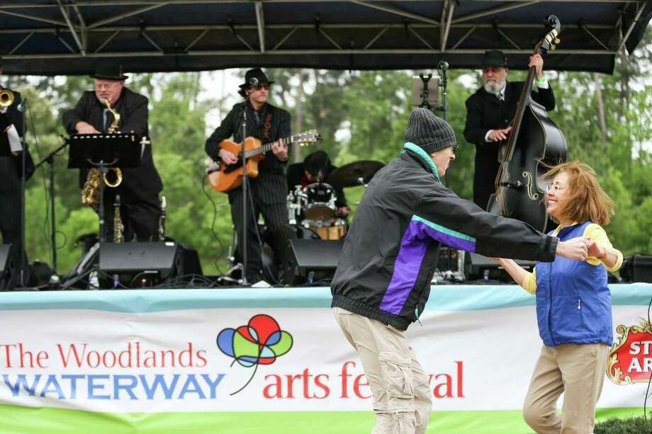 Porter residents Karl and Lupe Sharrah dance to music played by the Texas Gypsies during The Woodlands Waterway Arts Festival on Saturday, April 7, 2018, in The Woodlands. The festival staff and leadership of The Woodlands Arts Council are preparing for the 15th annual festival, which is slated for April 4-5, 2020. Photo: Michael Minasi, Staff Photographer / Houston Chronicle / © 2018 Houston Chronicle