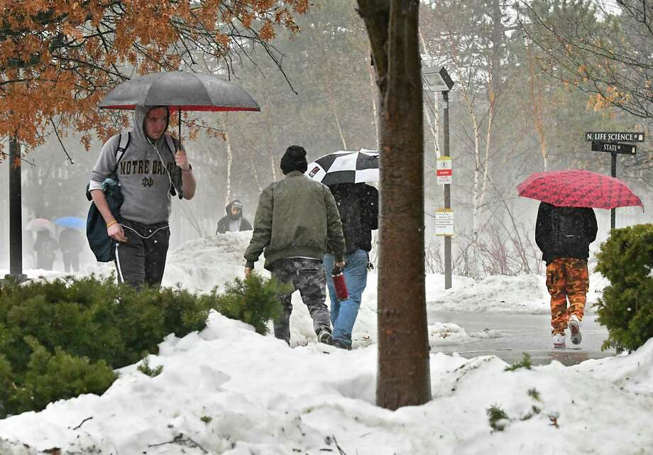 Another snowstorm is bearing down on the Capital Region with up to a foot of snow possible between Tuesday and Wednesday. Students walk with umbrellas at University at Albany during a foggy rainy day on Thursday, Jan. 24, 2019 in Albany, N.Y. (Lori Van Buren/Times Union) Photo: Lori Van Buren, Albany Times Union / 40046028A