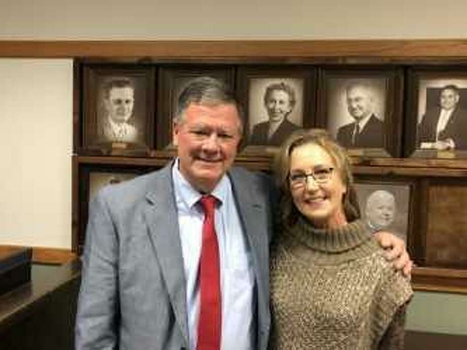 Cleveland interim athletic director/head football coach Norris Taff was approved by the school board to be the new athletic director/head football coach for the Indians. Taff is accompanied by his wife Julie Taff. Photo: Staff Photo/Marcus Gutierrez