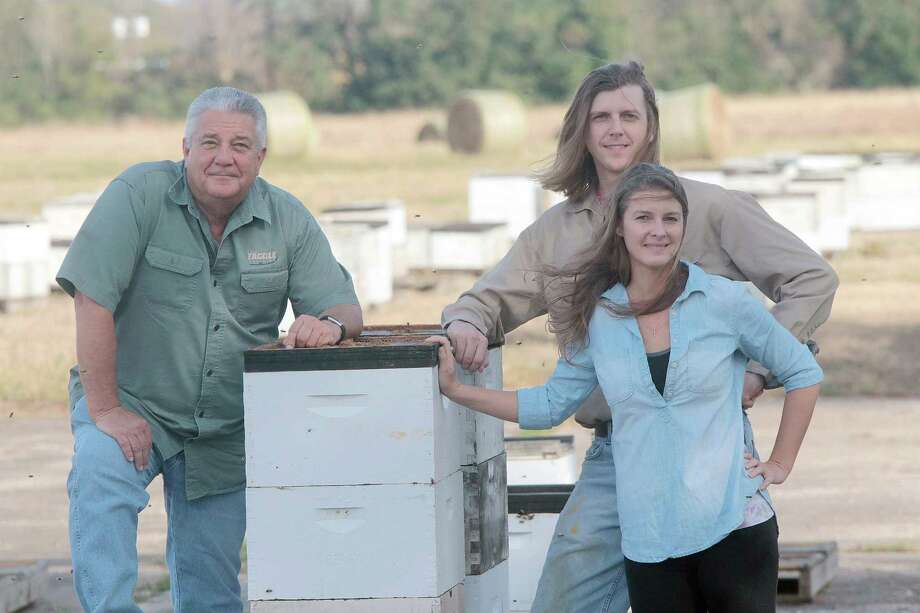Jerry, O.T. and Lauren Stroope work a family farm that provides honey sold in stores throughout the region. Photo: Pin Lim, Freelance / Pin Lim / Copyright Forest Photography, 2019.