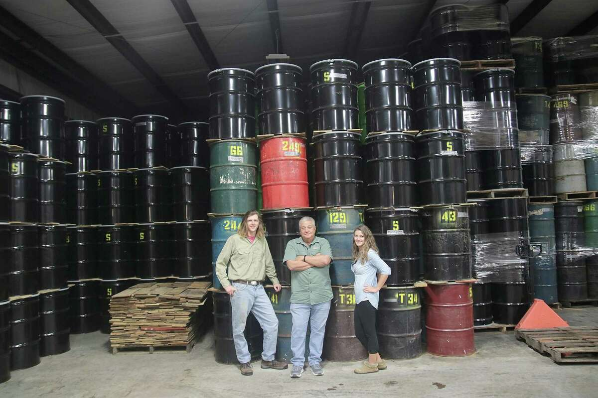 O.T., Jerry and Lauren Stroope stand by a season's honey harvest.