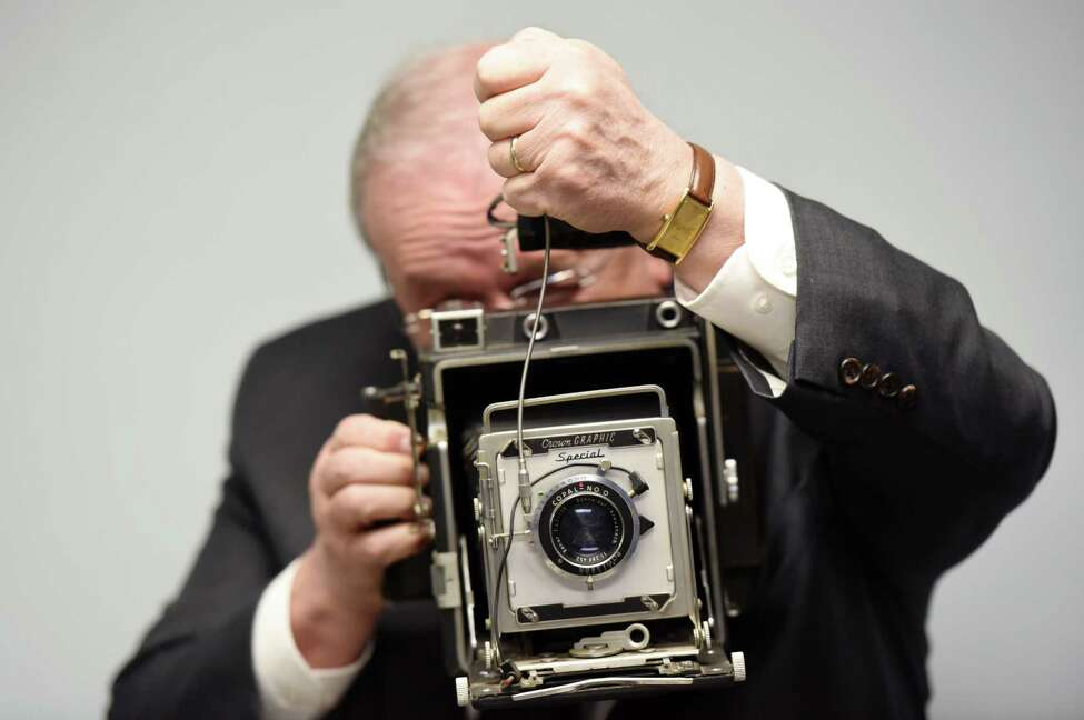 Assistant Chief Tom Ross demonstrates how he used to use the Crown Graphic Camera to take mugshots Thursday, Jan. 17, 2019 at the Cohoes Police Station in Cohoes, N.Y. (Phoebe Sheehan/Times Union)