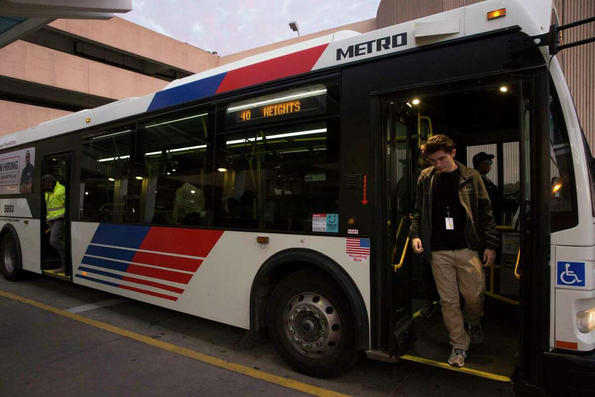 Passengers get off a METRO Transit Route 40 bus at William P. Hobby Airport transit center .