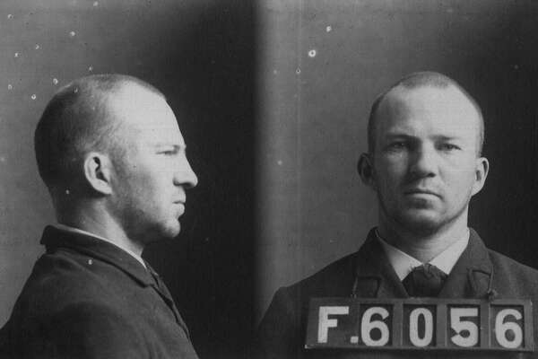 "George F. Donahoe, a 29-year-old pastry cook had his mugshot taken at the Albany County Penitentiary after he was found guilty of ""keeping a disorderly house,"" a brothel, and was sentenced to six months or a $250 fine. Donahoe's countenance is one of 13,708 Bertillon Card File mugshots that have survived more than a century, finding a home in the Albany County Hall of Records after the sheriff's office sent them.  (Albany County Hall of Records)"