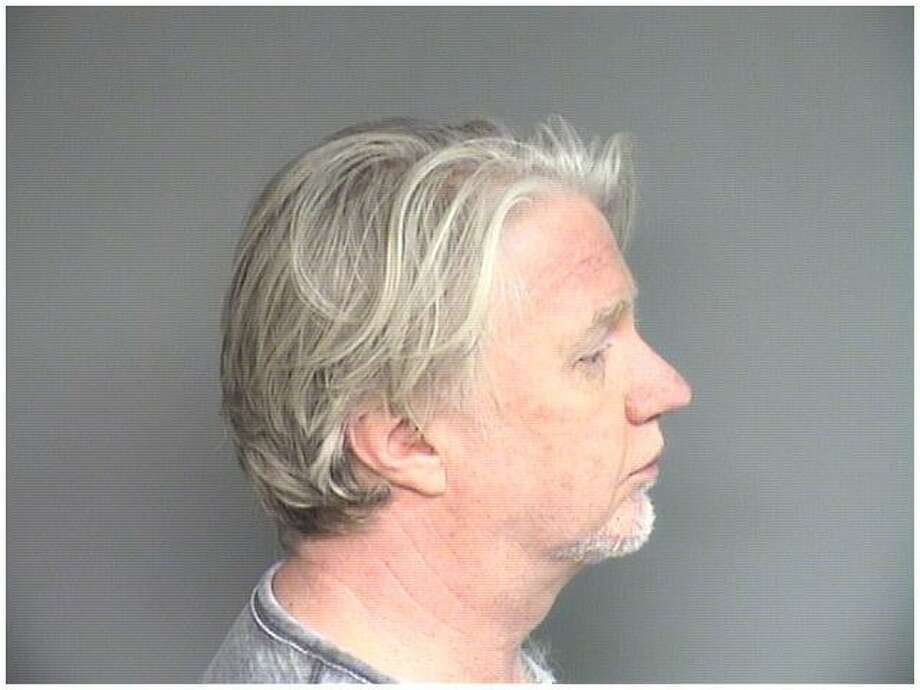 Tim Gemelli 52, of Greenwich, was charged with three counts of voyeurism by Stamford police. Photo: Stamford Police / Contributed