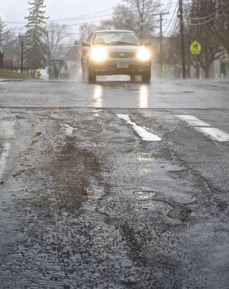 Pot holes and rough road surface on Park Avenue. Thursday, January 24, 2019, Danbury, Conn. Photo: H John Voorhees III / Hearst Connecticut Media / The News-Times