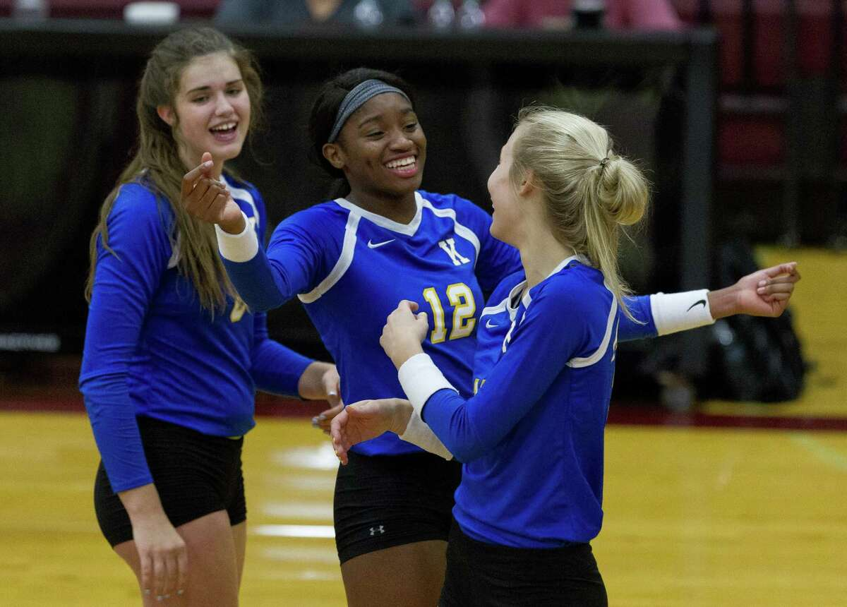 Klein's Nena Mbonu (12) reacts after a point by Ashlen Jennings (10) in front of Abby Sweeney (8) during the second set of a non-district volleyball match at Magnolia West High School on Wednesday, Aug. 15, 2018, in Magnolia. Mbonu and Jennings were both selected as an outside hitter honorable mention in the Texas Sports Writers Association 2018 All-State volleyball teams.