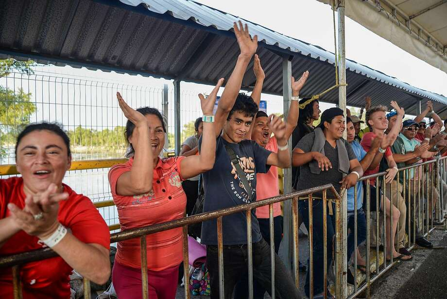 Migrants seeking humanitarian visas greet Mexico's secretary of the interior, Olga Sanchez Cordero (not pictured), during her visit to Ciudad Hidalgo on the border with Guatemala. Photo: Luis Villalobos / EFE / Tribune News Service