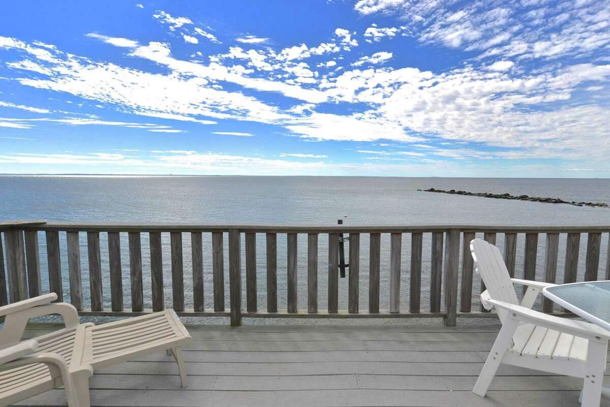 Part of a community of 26 beachfront homes, the cottage at 137 West Beach Drive in Stratford directly overlooks Long Island Sound. It's close enough that the current owners installed a spot to hold fishing poles, so they could fish right off their deck. The 1,257 square-foot home not only has a spectacular view, it also has an open floor plan, offering a spacious living area, as well as large kitchen. Though it was built in 1923, it's been remodeled over the years and has all the amenities of a modern beach house.
