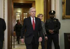 Senate Majority Leader Mitch McConnell, R-Ky., steps out of the chamber prior to a vote on ending the partial government shutdown, at the Capitol in Washington, Thursday, Jan. 24, 2019. (AP Photo/J. Scott Applewhite)
