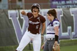 Magnolia's Julia Herzinger (5) reacts after making it to third base on an error at second during the softball game against Willis on Tuesday, April 17, 2018, at Willis High School. (Michael Minasi / Houston Chronicle)