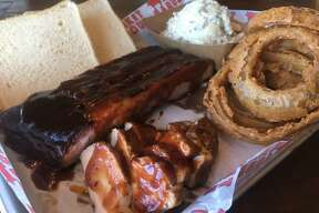 A selection of pork spare ribs, smoked turkey, onion rings and potato salad from Market Barbecue. Market Barbecue is in the process of adding a full bar to its 2707 SE Military Dr. location and is opening a second restaurant on Bitters Road near Highway 281.