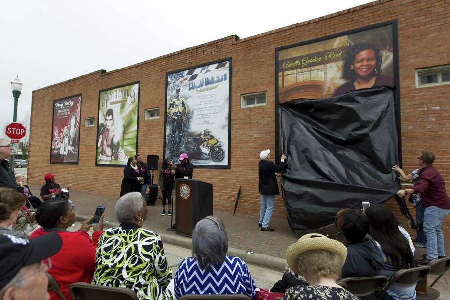 A mural in honor of Annette Gordon-Reed is unveiled at North Main Street and Metcalf Street, Saturday, April 22, 2017, in Conroe. The fourth addition to the Conroe Legends mural wall honored the 1977 graduate of Conroe High School and winner of the 2009 Pulitzer Prize in History. On Feb. 15, a bust of Gordon-Reed will be unveiled in Founder's Plaza in downtown Conroe. Photo: Jason Fochtman, Staff Photographer / Houston Chronicle / © 2017 Houston Chronicle