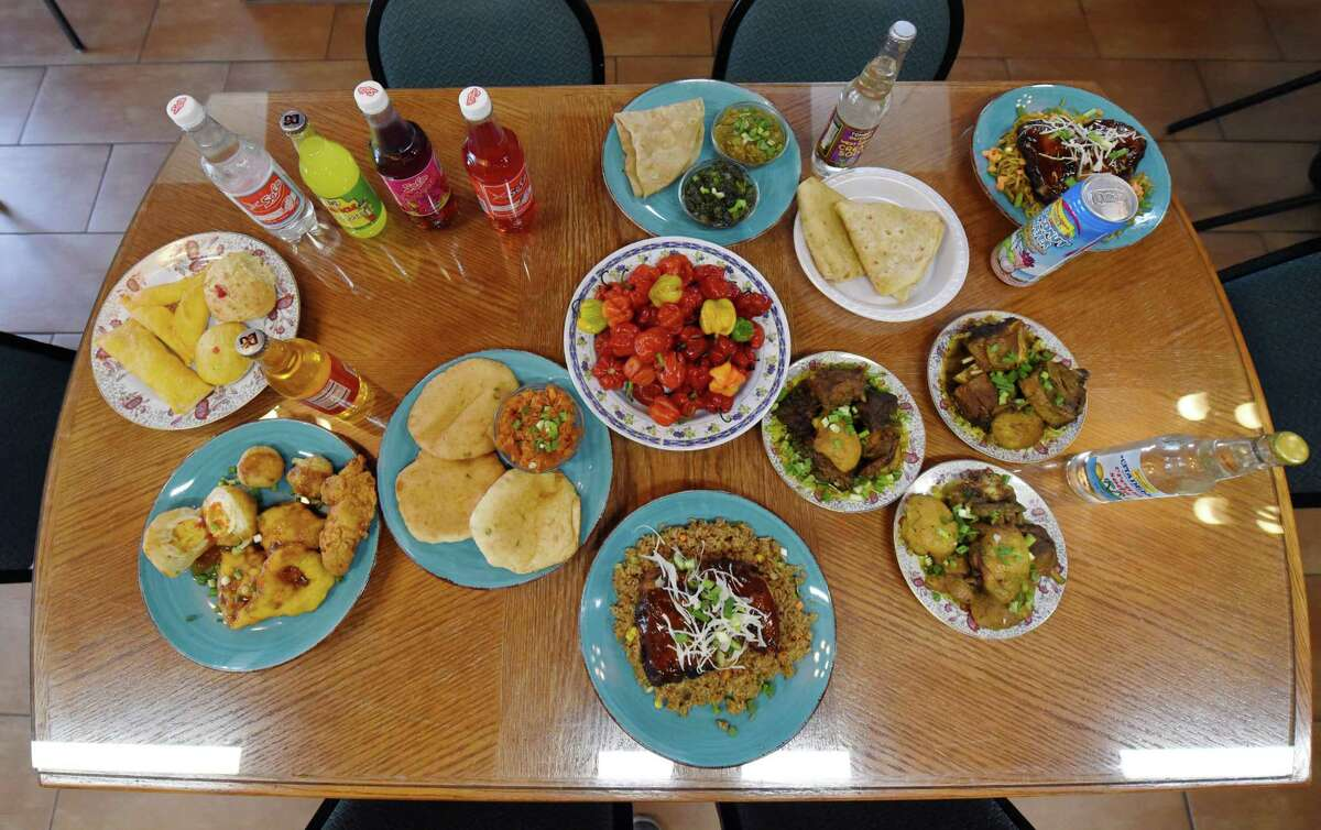 Various plates of food sit on a table Tuesday, Jan. 15, 2019 at A Taste of Guyana Schenectady, N.Y. (Phoebe Sheehan/Times Union)