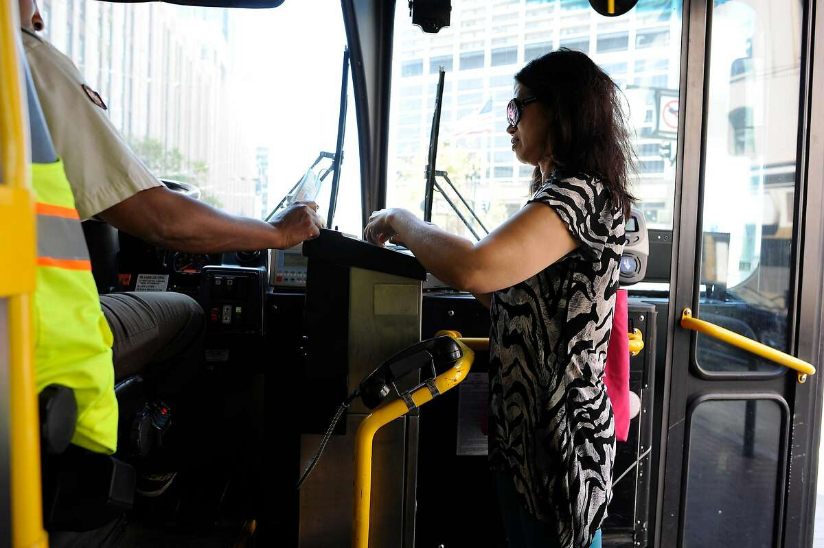 A woman pays her fare on a 9 San Bruno MUNI bus in San Francisco in 2015. A new study shows women are less likely to take mass transit due to safety concerns.