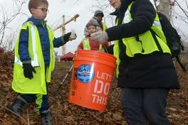Westport resident Emma Cusato and her children, Jimmy, 8, and Anna, 5, pick up trash as Surfrider and SkipThePlasticNorwalk.org organize a clean-up of Oyster Shell Park in support of Norwalk's plastic bag ban on Jan. 19 in Norwalk.